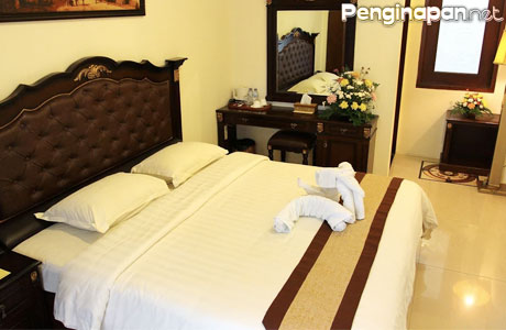 Kamar Deluxe Grand Palace Hotel