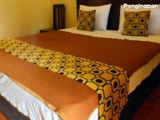 Penginapan Ani, kamar tidur dengan ranjang queen yang nyaman